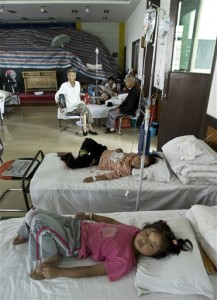 In this photo taken on Wednesday, Aug. 19, 2009, village children affected by lead poisoning from the Dongling Lead and Zinc Smelting Co. plant receive medical treatment at a hospital in Fengxiang county, west of Xi'an, China. More than 1,300 children have been sickened by lead poisoning in Hunan province, the second such case involving a large number of children this month, state media said Thursday. (AP Photo/Andy Wong)